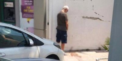 İlhan Şeşen Bodrum'da Banka Duvarına İşedi, Sosyal Medyanın Konusu Oldu