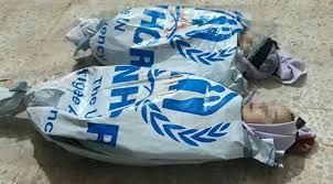 Kahreden Görüntüler! Esad'ın Katlettiği Çocukların Cesetleri BM Çuvallarına Kondu