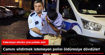 Camını Sildirmek İstemeyen Polisi Öldüresiye Dövdüler, Halkın Linç Girişiminden Yine Polis Kurtardı!